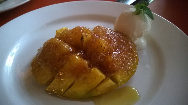 Mango brulee with vanilla ice cream